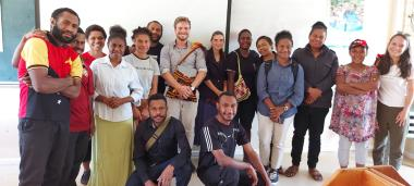 Alexandre Lafargue, Official Representative of New Caledonia to Papua New Guinea, with students learning French and Indonesian